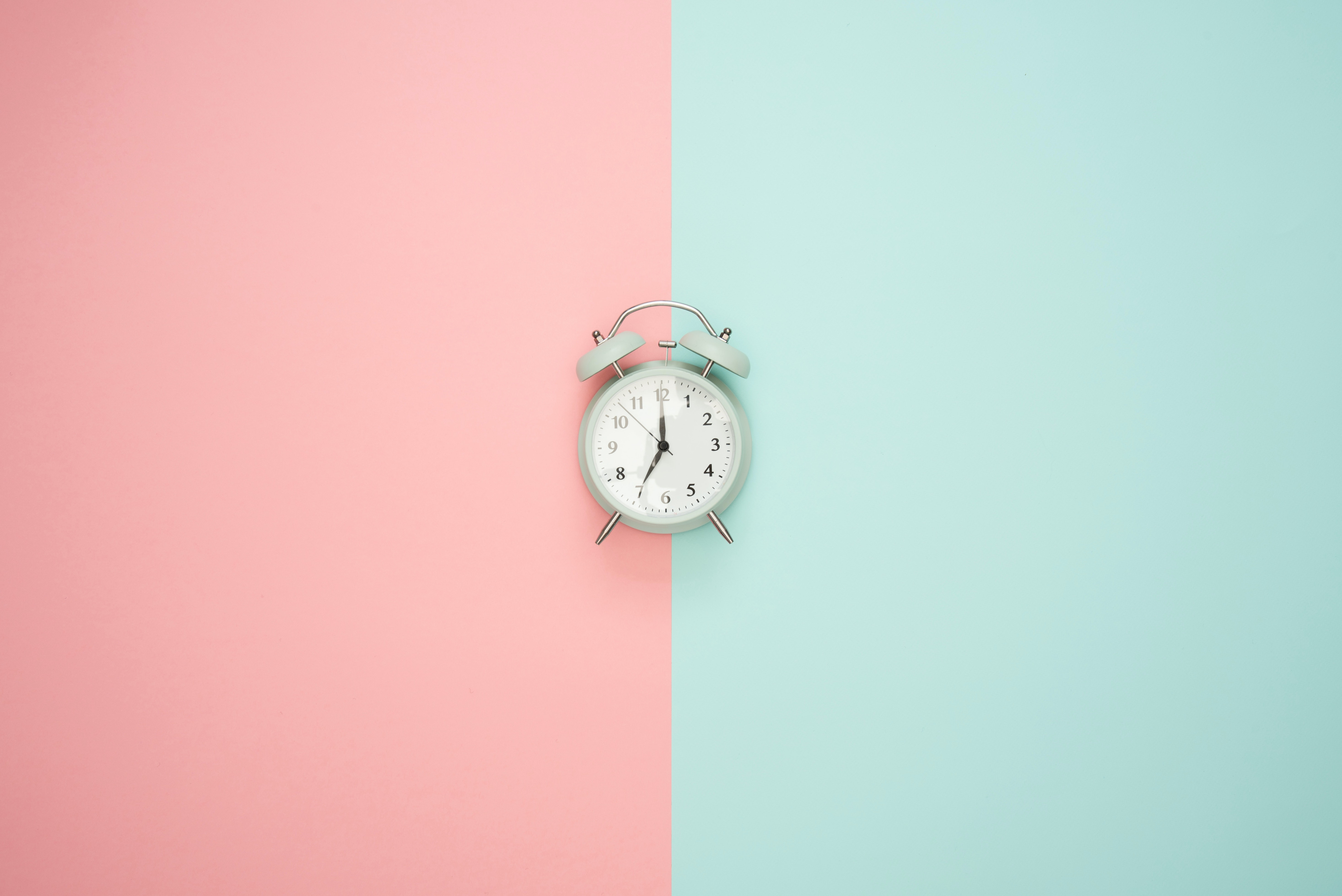 PInk and blue background picture of clock